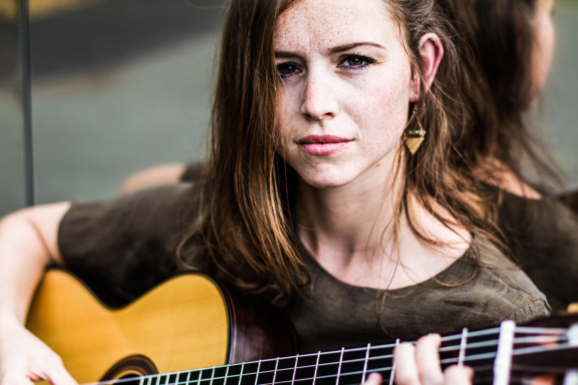 Jessica Kaiser playing guitar